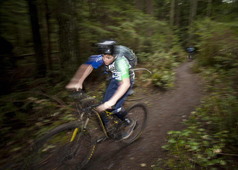 "Sebastian ""Seabass"" Belkin, of the Gear Grinders middle school mountain bike racing team, works through a practice ride."