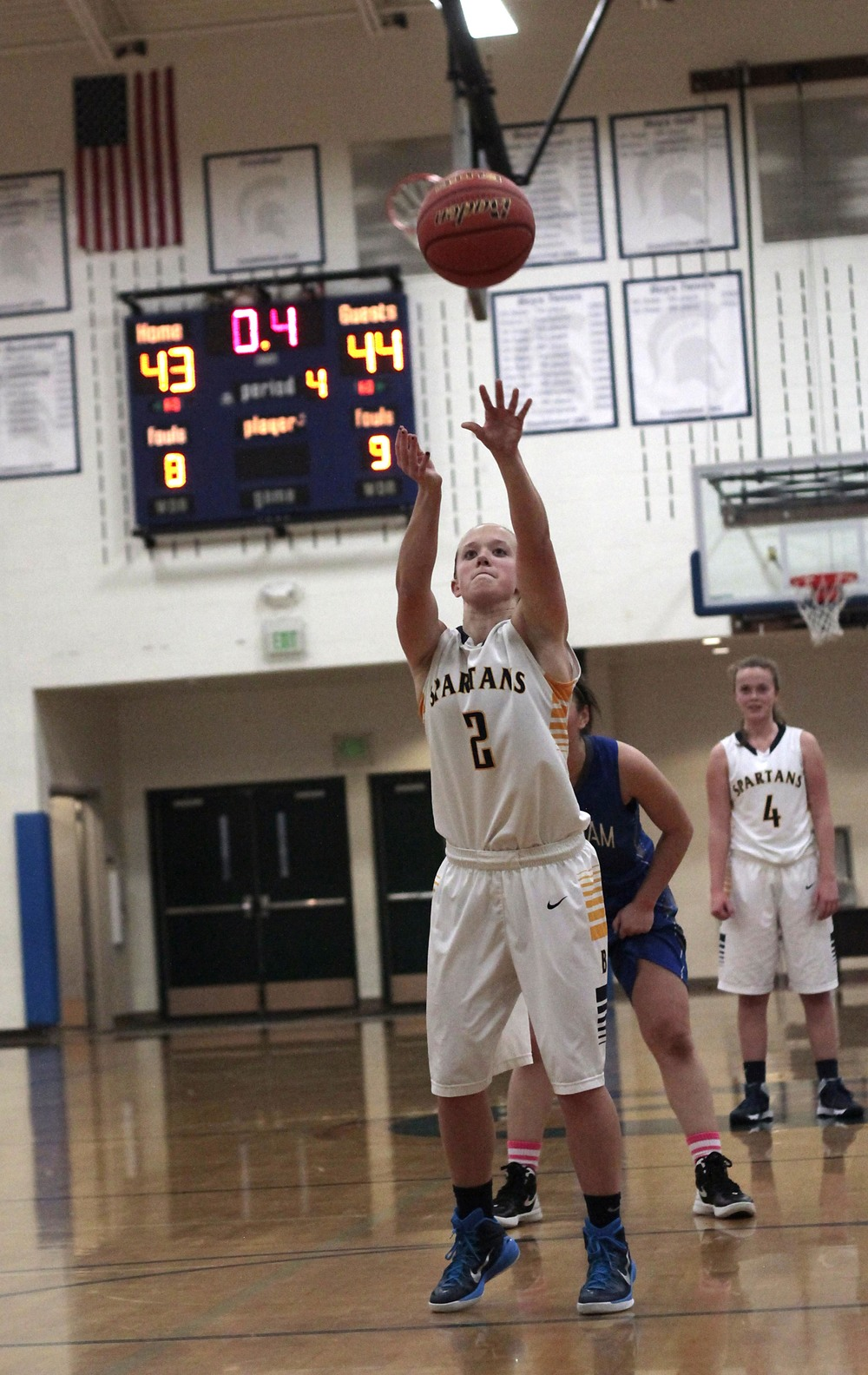Bainbridge High School senior guard Paige Brigham attempts a free throw that tie the team's first 2015 postseason outing with less than half a second of play remaining.