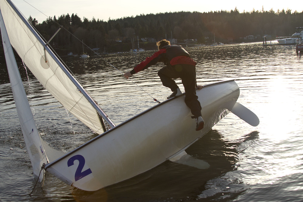 Students on the Bainbridge High School sailing team struggled through capsize drills during the initial days of practice on the water, a chilly — but necessary — early season requirement for competition.