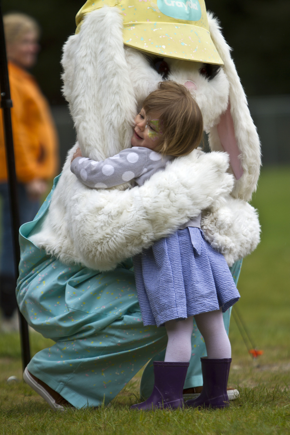 Frankie Rohan, 2, gives the Easter Bunny a big hug at the annual Easter egg hunt at Strawberry Hill Park Saturday.