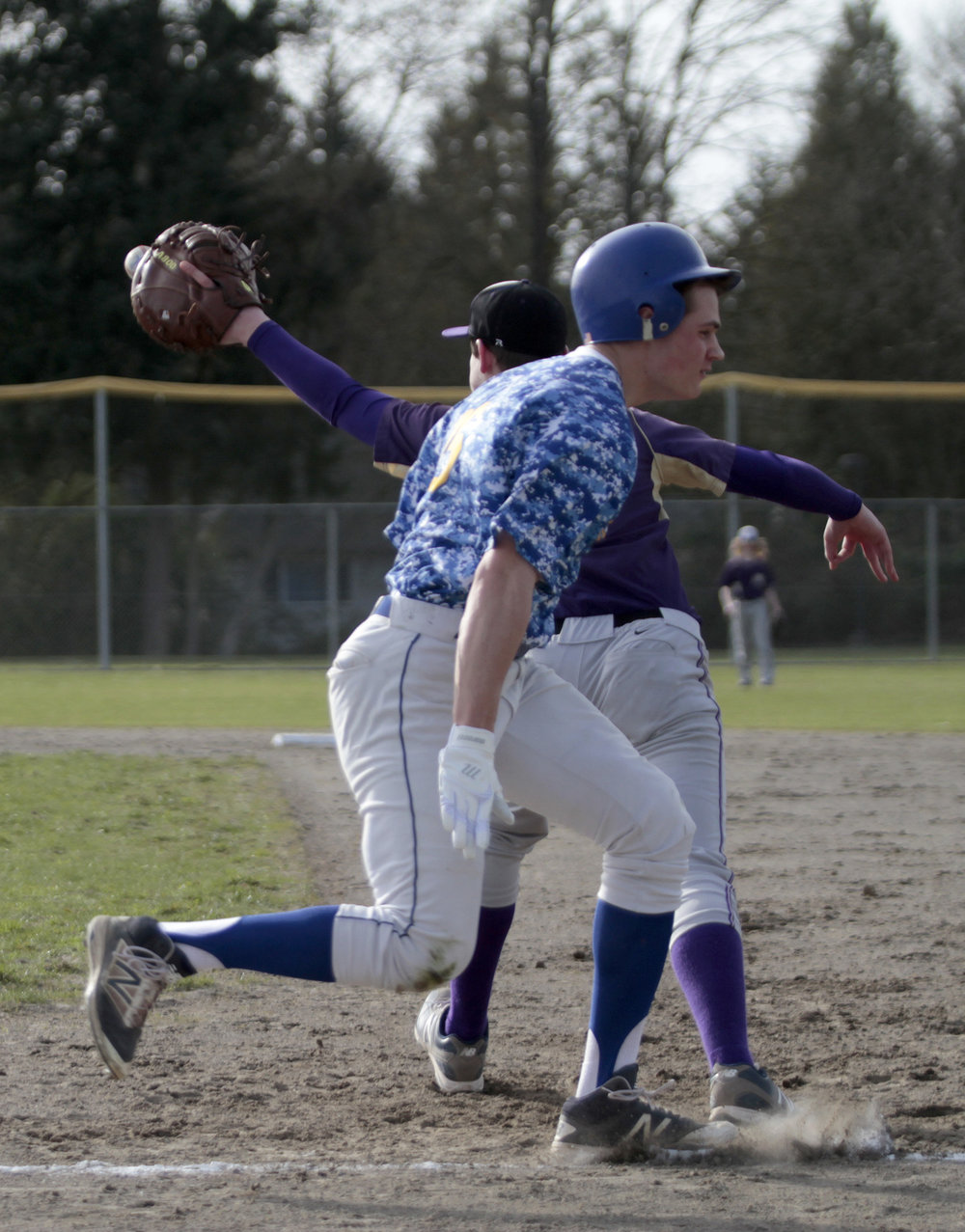 Bainbridge High School senior Ian Matthews runs to a  close call at first base.