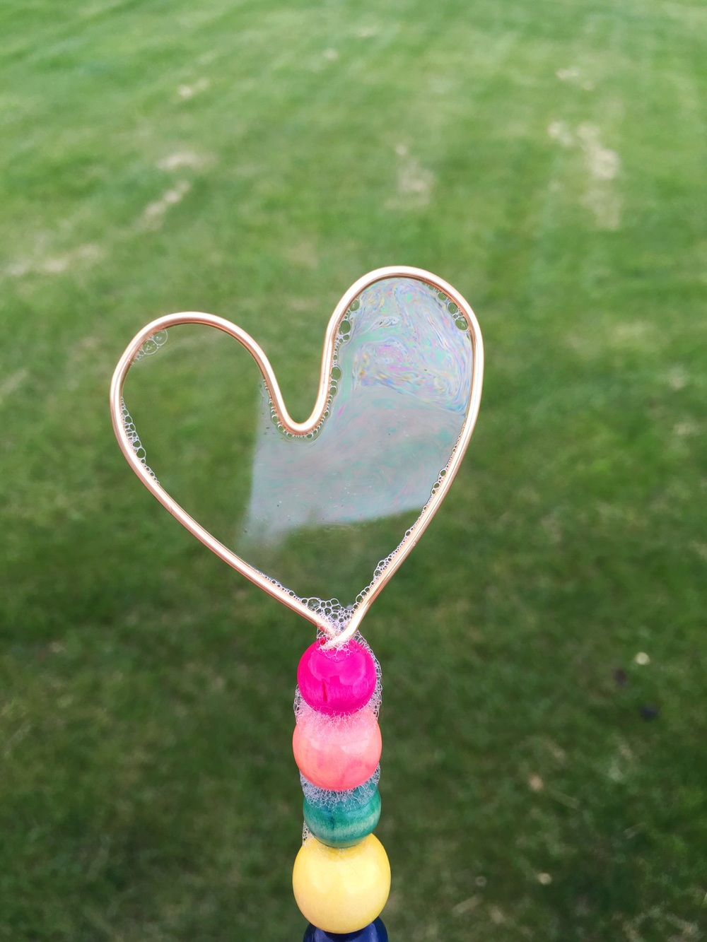 Make your own bubble wands. Click through for tutorial.