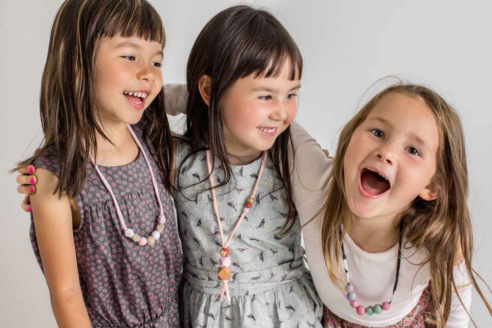 These cuties in their Willa petite, Penny geo doll, and Chloe petite necklaces, and  Wheat Kids Clothing  outfits