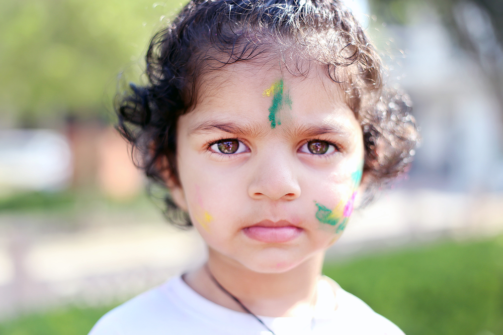 Child celebrating Holi - Mathura, India
