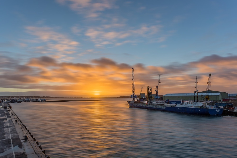 Sunrise shot taken from Poole Quay looknig towards Sandbanks and the Port of Poole