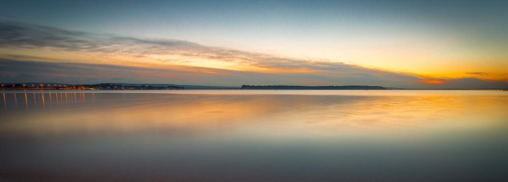 Sunset over calm waters, Sandbanks, Dorset