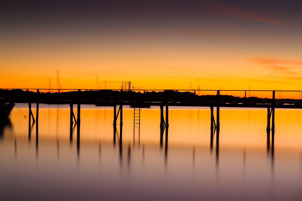 Jetty at sunset with long exposure by Rick Mcevoy Poole Photographer