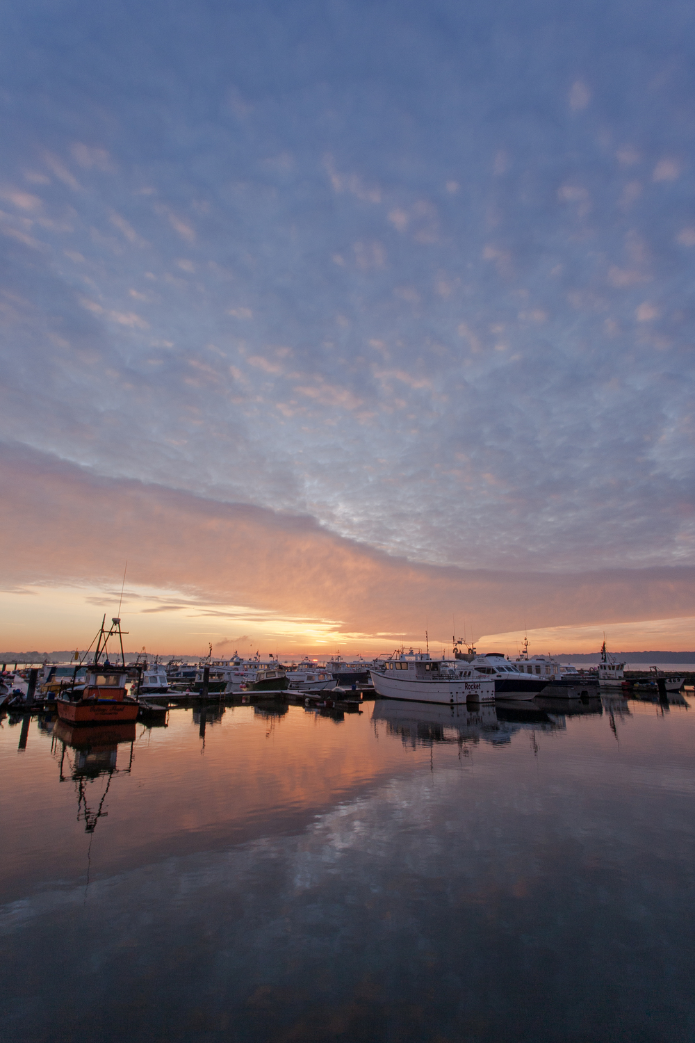 Sunrise looking towards Sandbanks from Poole Quay – Pictures of Poole by Rick McEvoy