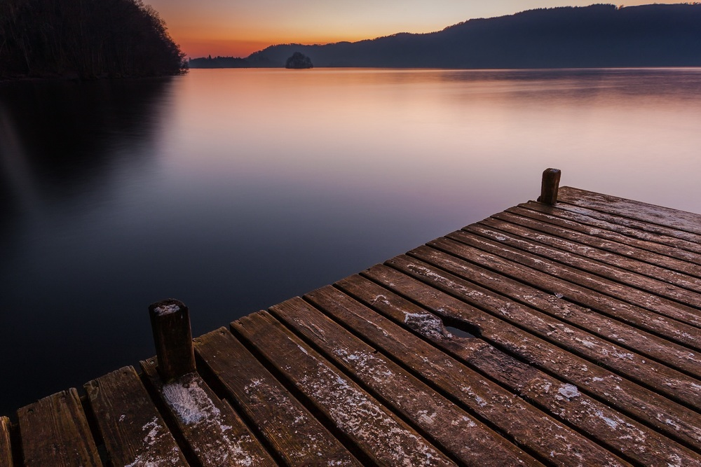 A stunning sunset over a flat calm Lake Windermere - Landscape Photography by Rick McEvoy