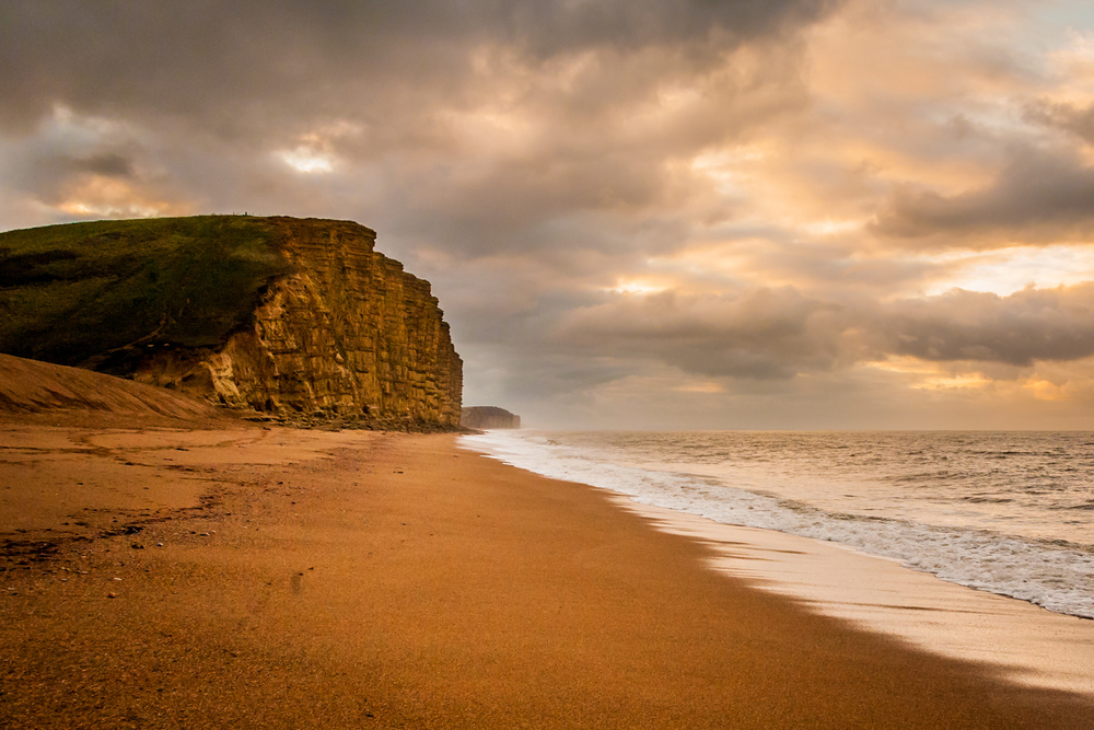 West Bay beach and cliffs