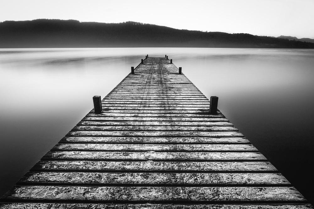 Black and white picture of a jetty on Lake Windermere by landscape photographer Rick McEvoy