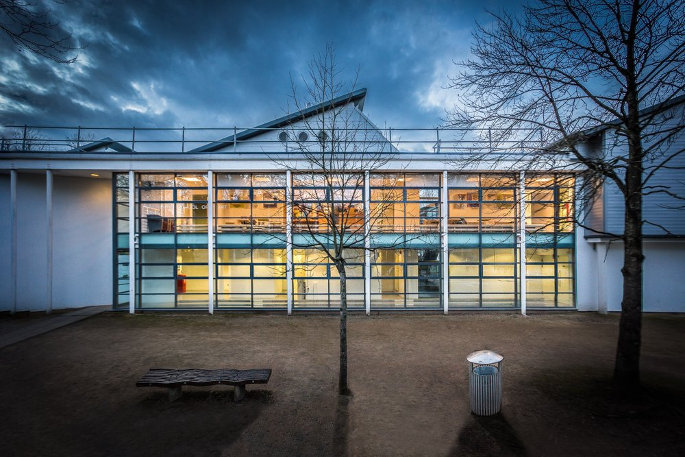 Picture of the new extension to Winchester School of Art, part of the University of Southampton. A stylish extension with interesting street furniture in the foreground.