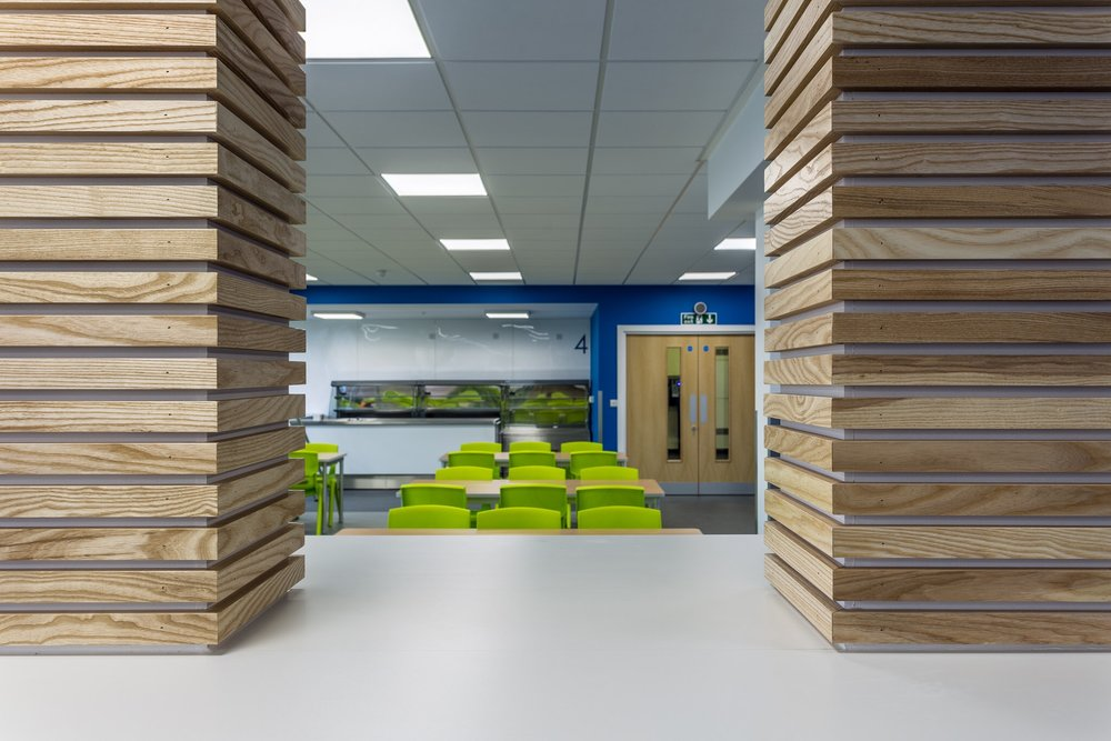 School dining room with a flash of colour in Hampshire. Interior design photography in Hampshire.