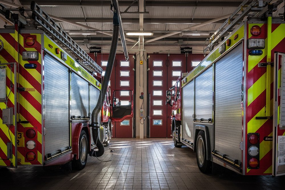 Fire engines in the brand new appliance bay at Dorchester Fire Station, Poundbury, Dorset