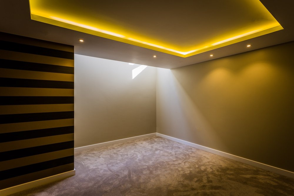 A bedroom with interesting lighting in a stunningly stylish new home in Poole