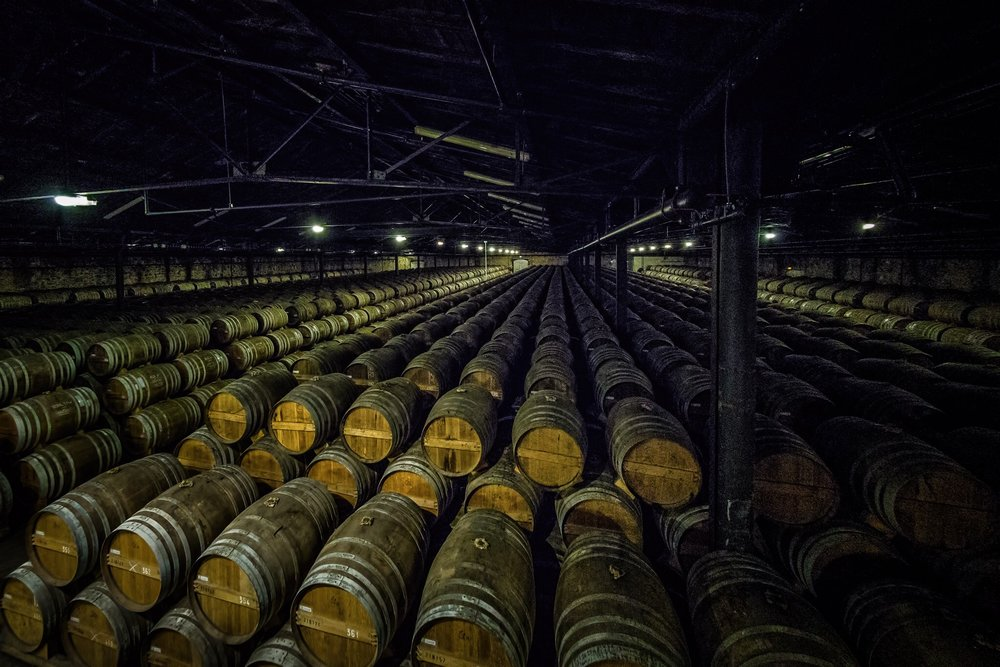 Barrels, Remy Martin, Cognac. Dark, moody, massive industrial space. Industrial photographer Rick McEvoy