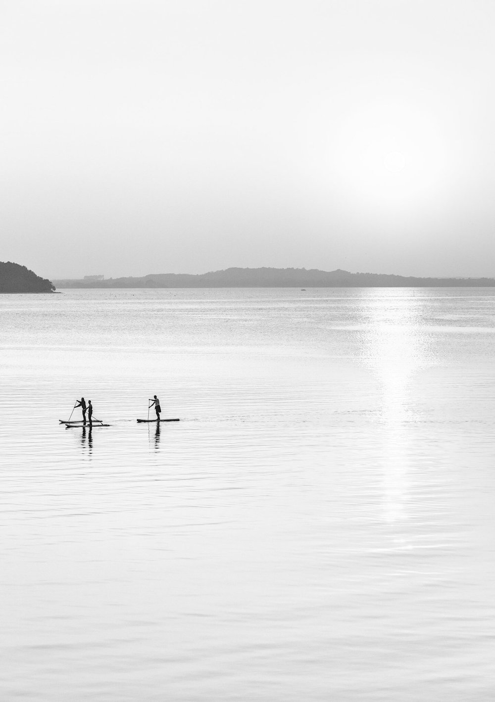 Paddle boarders photographed by Rick McEvoy Poole Photographer