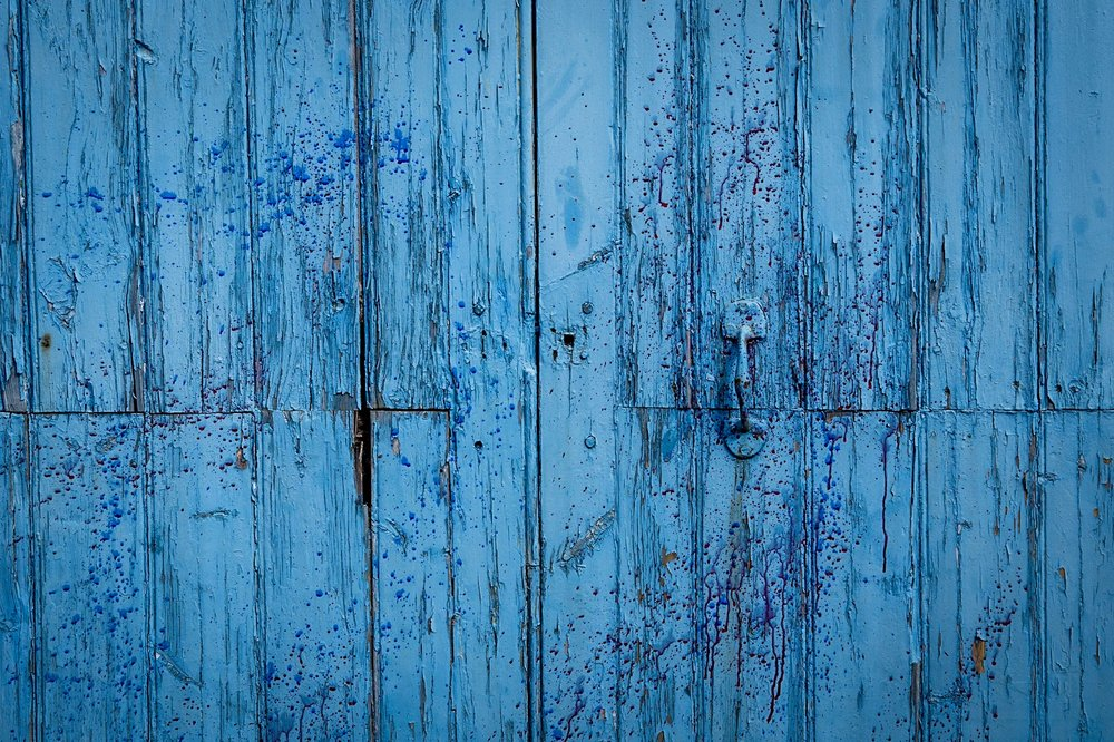 The textures In an old painted door