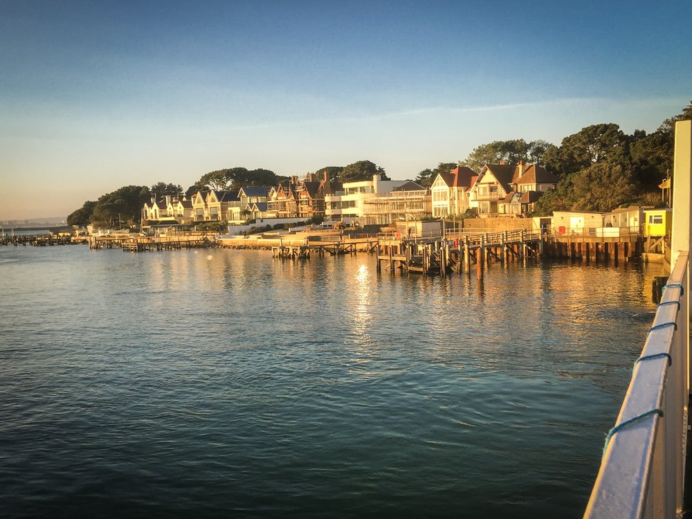 The view from the chain ferry today looking back to Sandbanks in Poole, Dorset illuminated by the late afternoon sun
