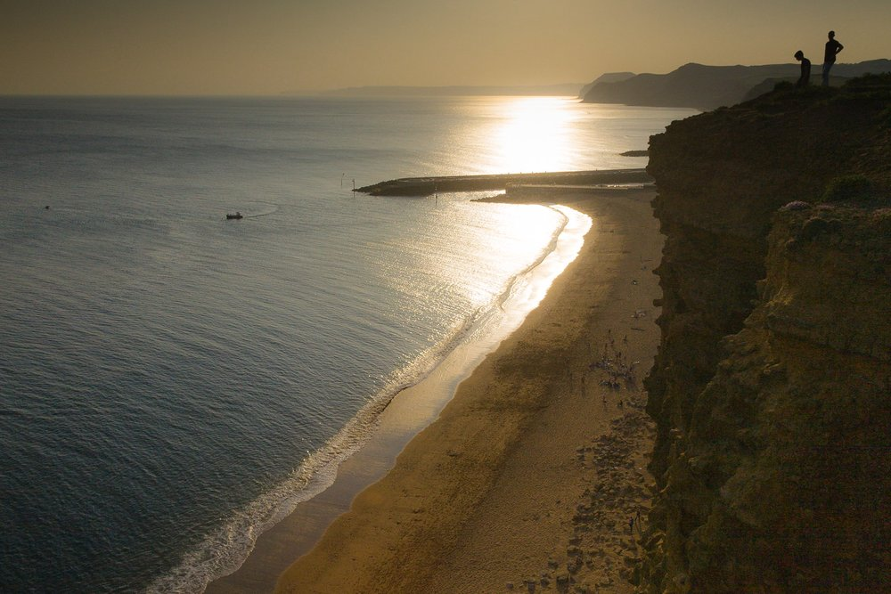 The view of the beach at West bay from the cliffs above