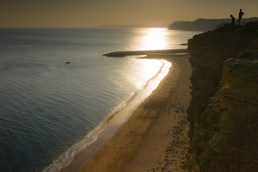 West Bay beach photographed from the cliffs above