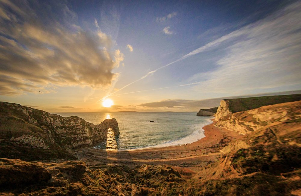 Durdle Door at sunset by Rick McEvoy