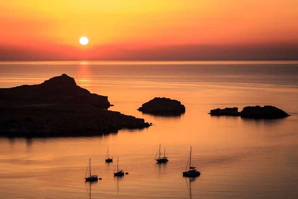 Lindos Bay at sunrise by travel photographer Rick McEvoy