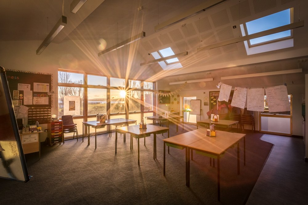 Interior photography of a light bright sunny classroom in Poole
