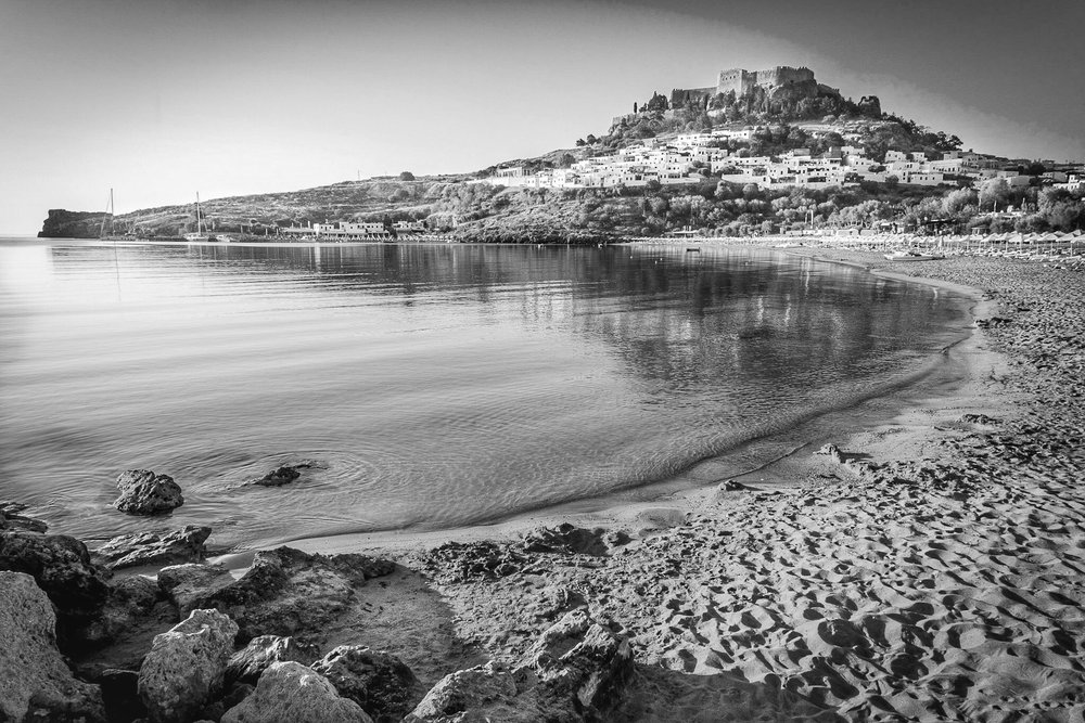 Lindos Bay - travel photography in black and white by Rick McEvoy