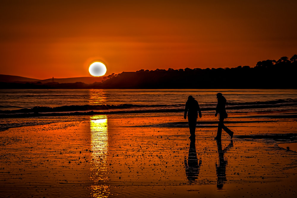 Walkers on the beach at sunset by Rick McEvoy Bournemouth Photographer