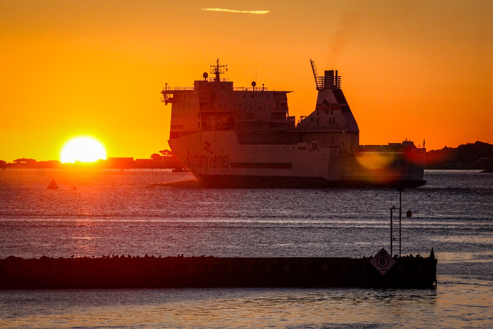 Boat leaving the port by Rick McEvoy industrial photographer in Poole
