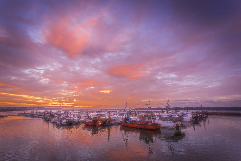 Poole Quay and boats at sunrise by Poole Photographer Rick McEvoy
