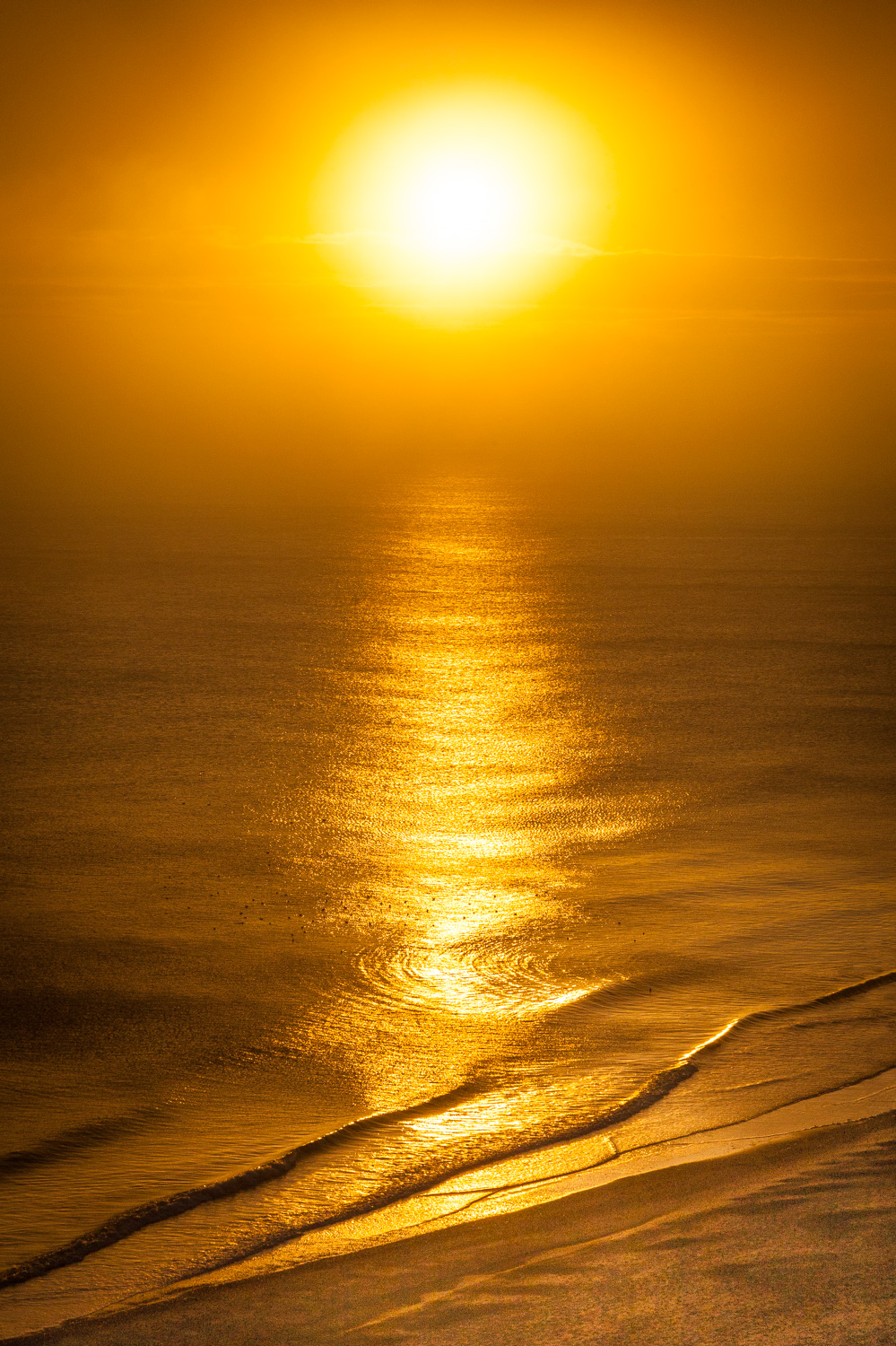Sun and waves by Rick McEvoy Bournemouth Photographer