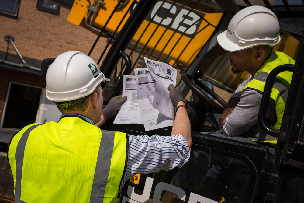 Plant operative receiving instruction by construction photographer Rick McEvoy