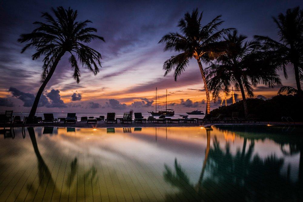 Sunset at Meeru Island Resort by Rick McEvoy Travel Photographer
