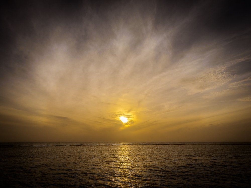 Misty sunset in the Maldives by Travel Photographer Rick McEvoy