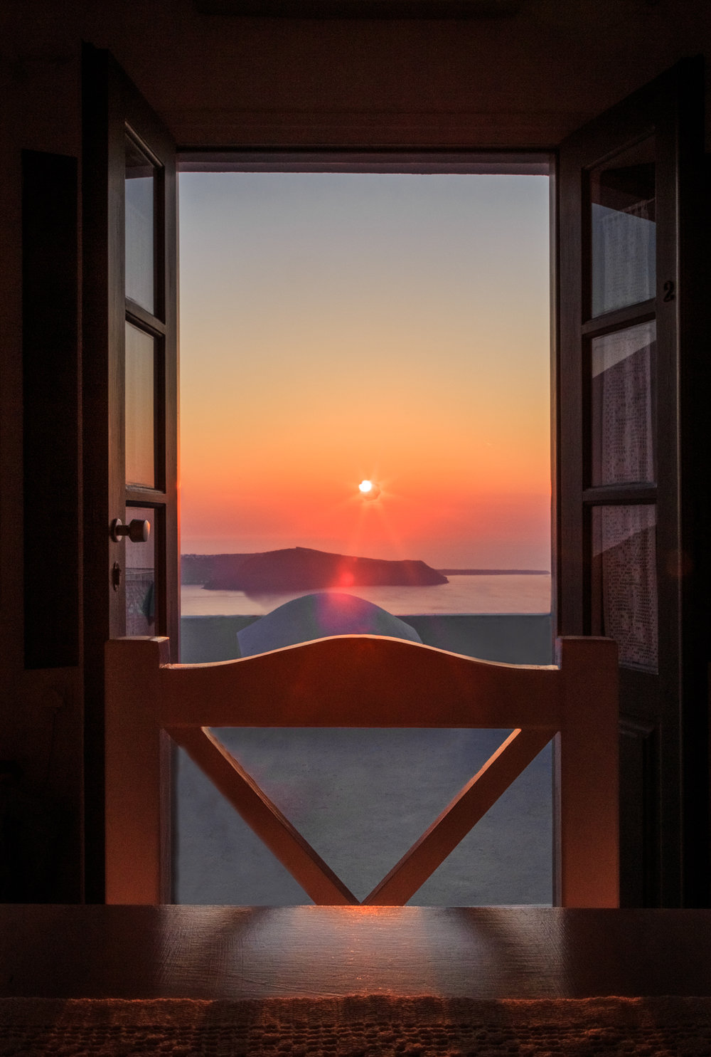 Santorini sunset by Rick McEvoy ABIPP - Travel Photographer