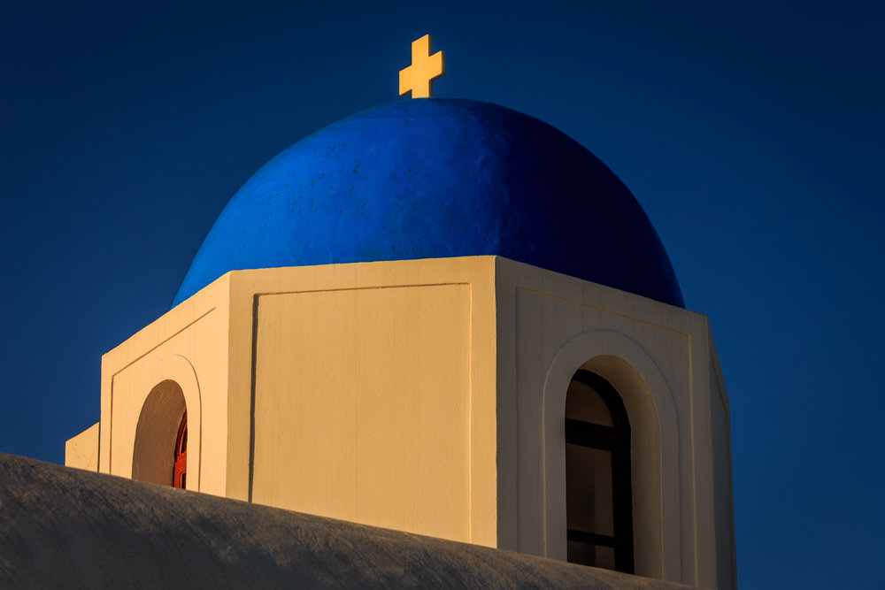 One of those stunning blue domed roofs of Santorini