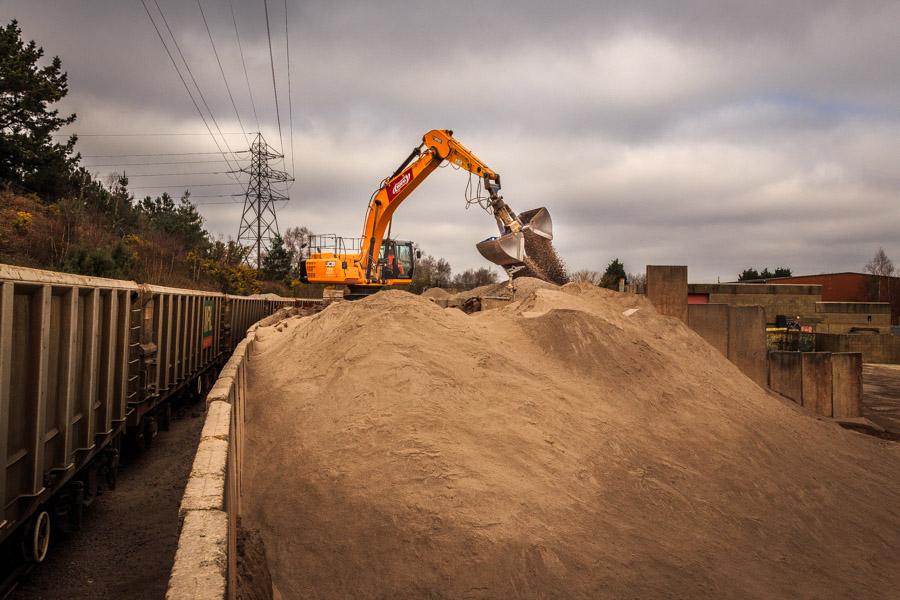 Unloading gravel at a rail siding facility
