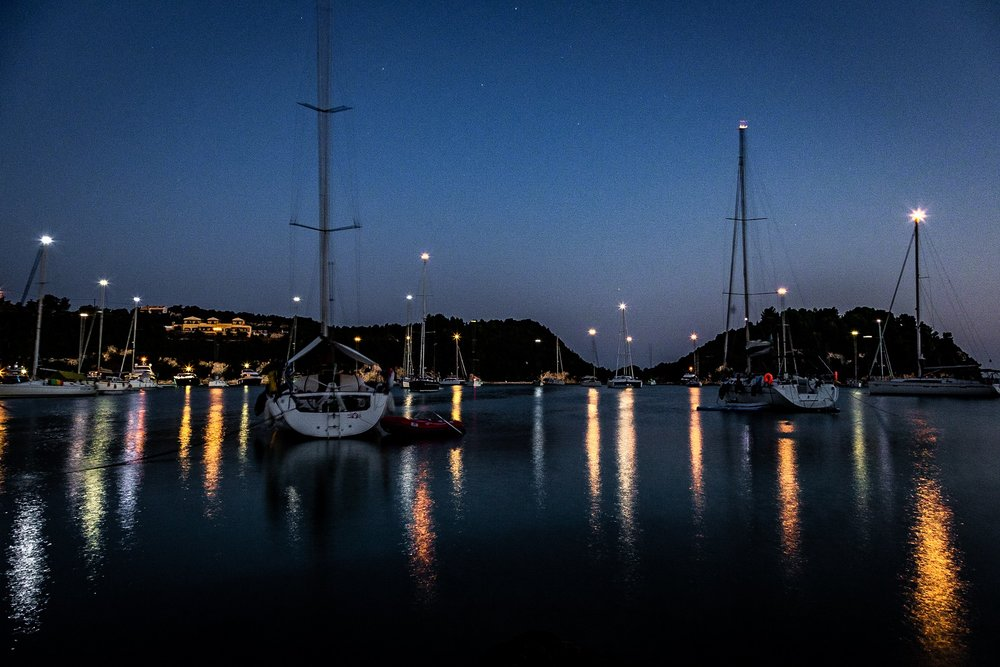 Boats in the night moored at Lakka on the Greek Island of Paxos