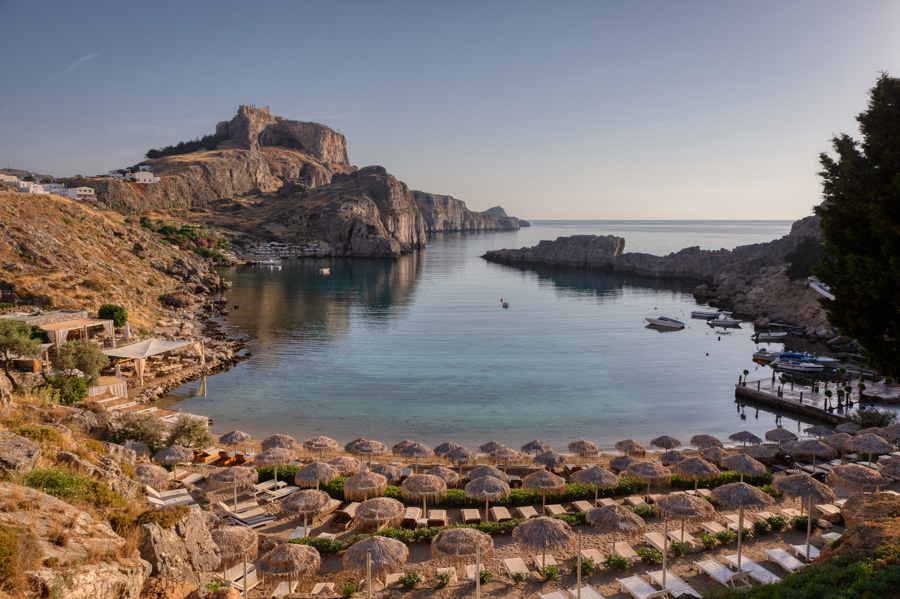 St Pauls Bay in Lindos at sunrise by travel photographer Rick McEvoy.jpg