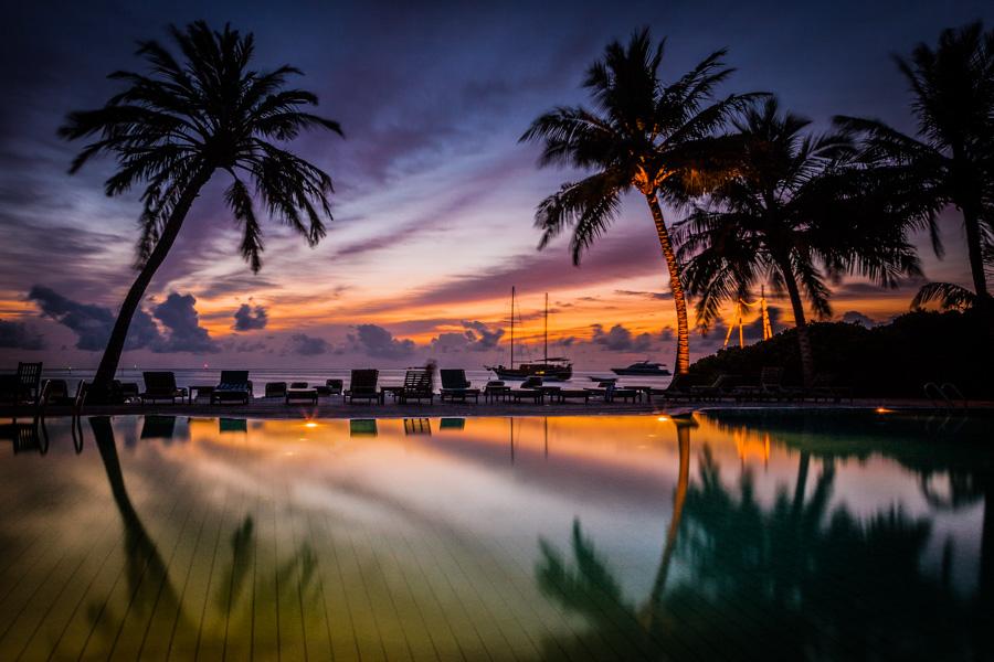 Swimming pool at sunset. Meeru Island Resort. Maldives