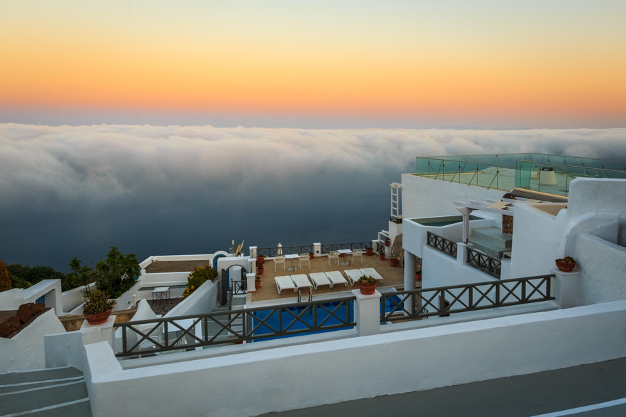 Sunrise with clouds below viewed from Kasimatis Suites in Santorini by Rick McEvoy