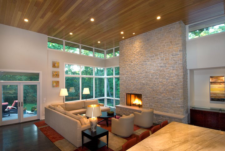 This client desperately wanted a large stone fireplace. We used real stone veneer (much thinner) to achieve the look without the weight.