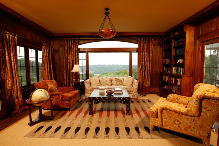 How relaxing is this custom library paneled in wormy Chestnut? With curated pieces like the Allegra Hicks custom rug and Leather Parson's cocktail from Chile, Brian Gibson's clients say: Very.