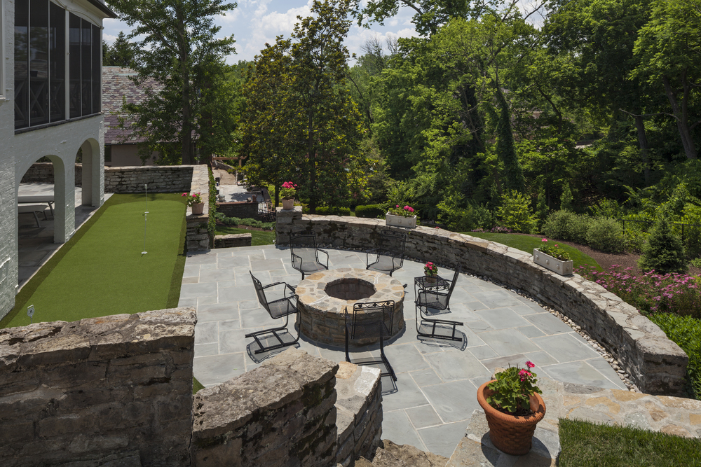 This happy DIGS client really digs the out-of-doors. Putting green. Fire pit. Plunge pool. Grilling courtyard. Screened porch. Yes we can and yes we did.