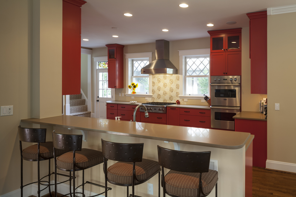 Believe it or not we tried very hard to talk these clients out of doing red cabinets.  The end result is spectacular. We were wrong but we did it right.