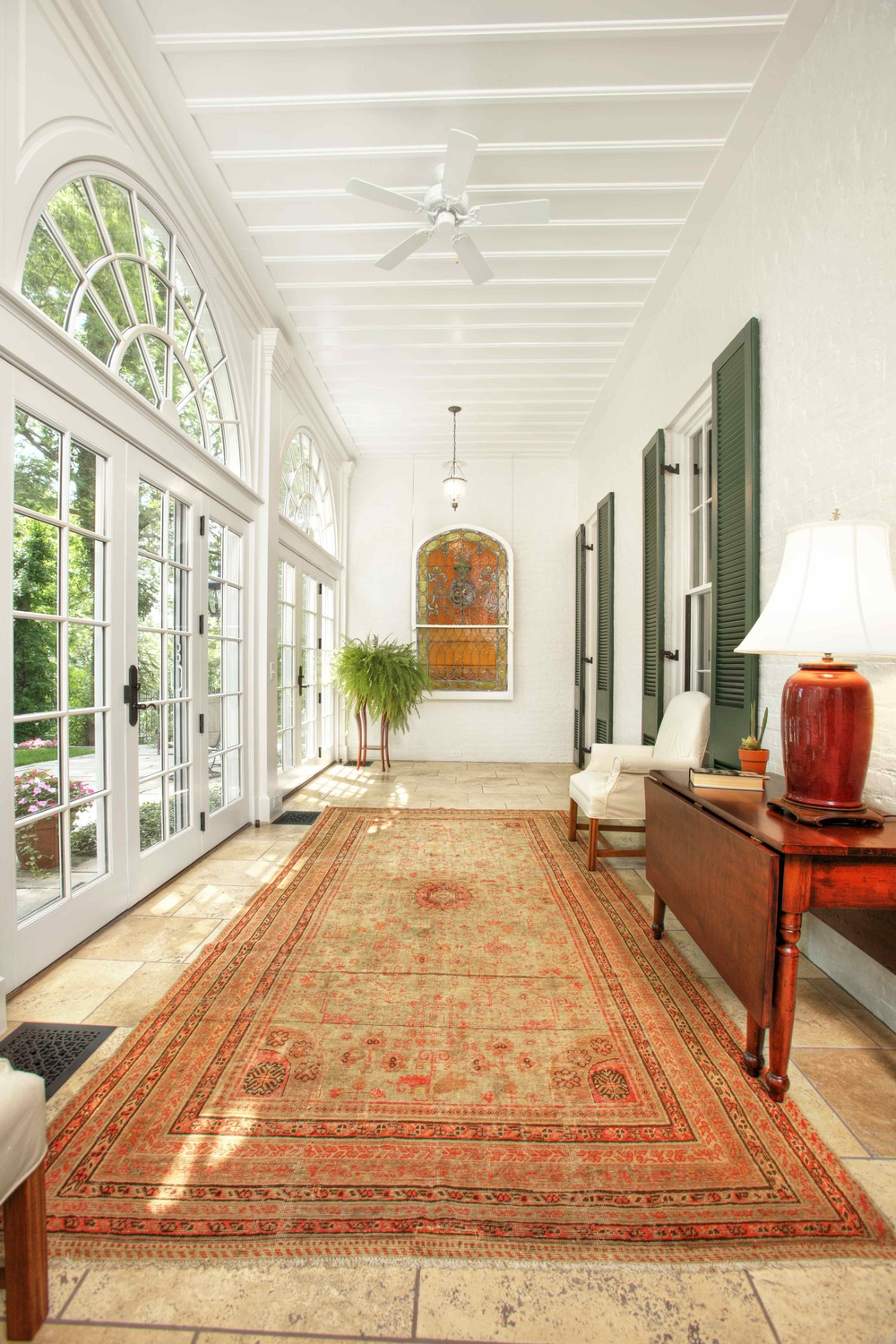 The right rug makes the room in this Covington, KY sunroom.