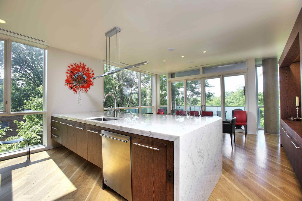 "Note the island in this spectacular Hyde Park condo kitchen…one of DIGS' designer John Harrison's favorite effects is to ""waterfall"" the counter surface all the way down to the floor."