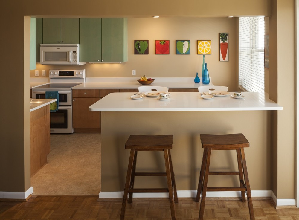 This condo kitchen at The Regency in Hyde Park is owned by a woman who dreams in turquoise. We delivered on her dreams.